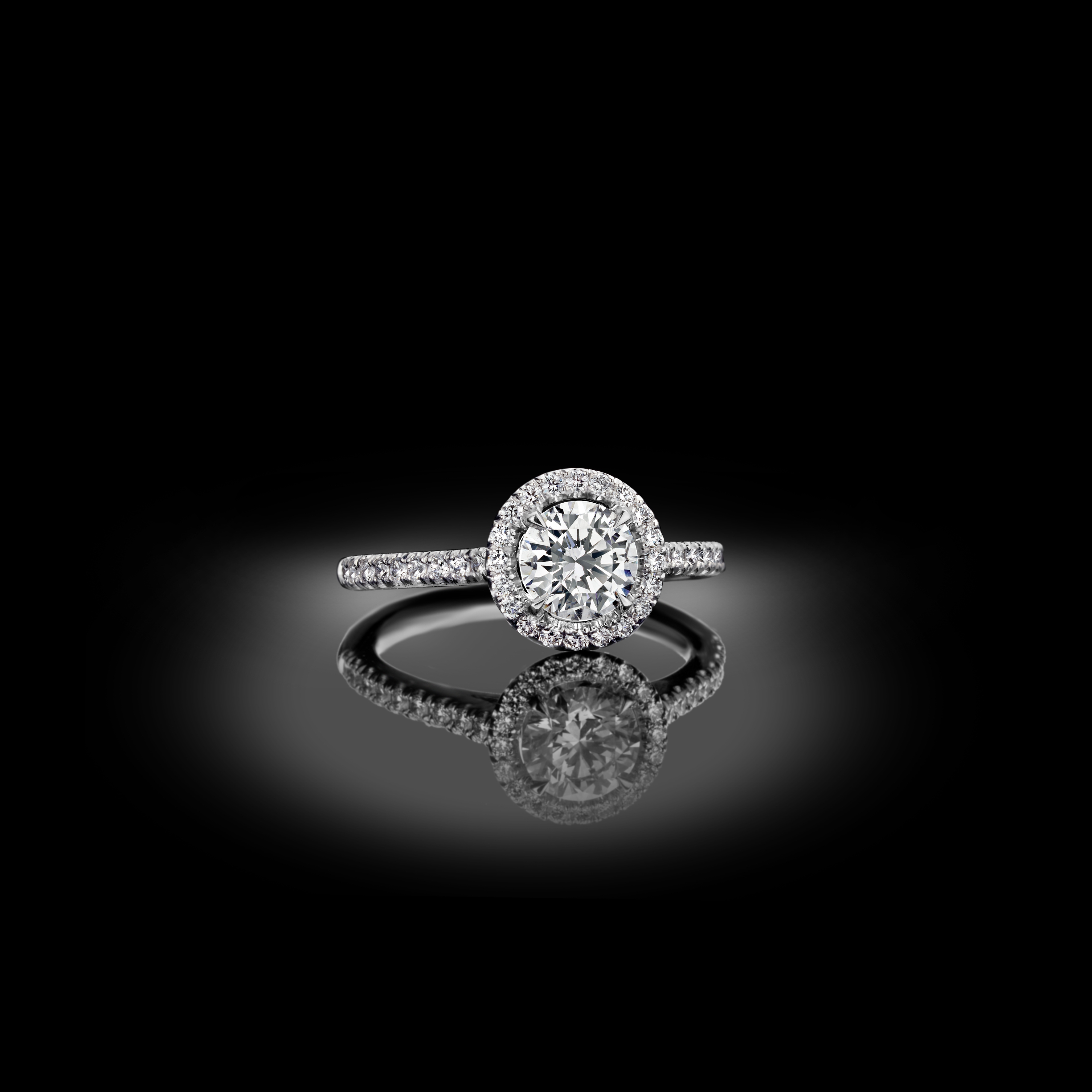 Classic and elegant, timeless halo engagement ring.