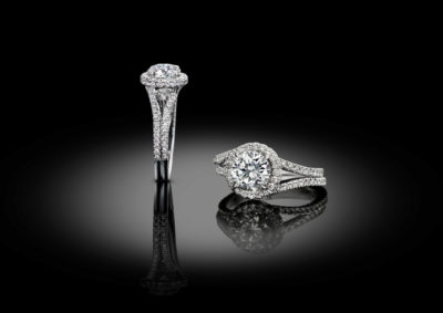 Contemporary engagement style solitaire ring entirely set with brilliant diamonds.