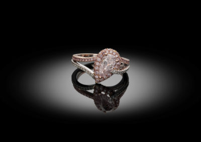 Very fine and unique engagement ring, set with a pink pear shape diamond, in a combination of white and pink.